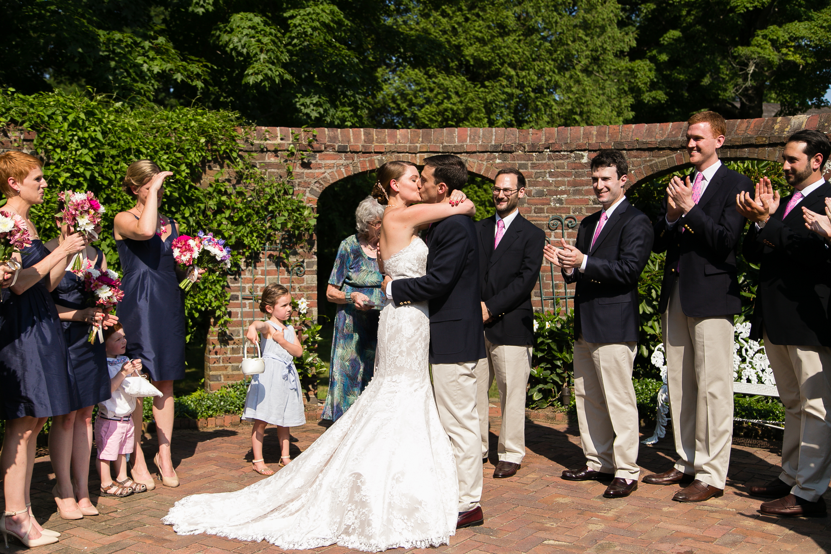 The bride and groom make it official during their intimate garden ceremony at Keller Tavern in Ridgefield, CT