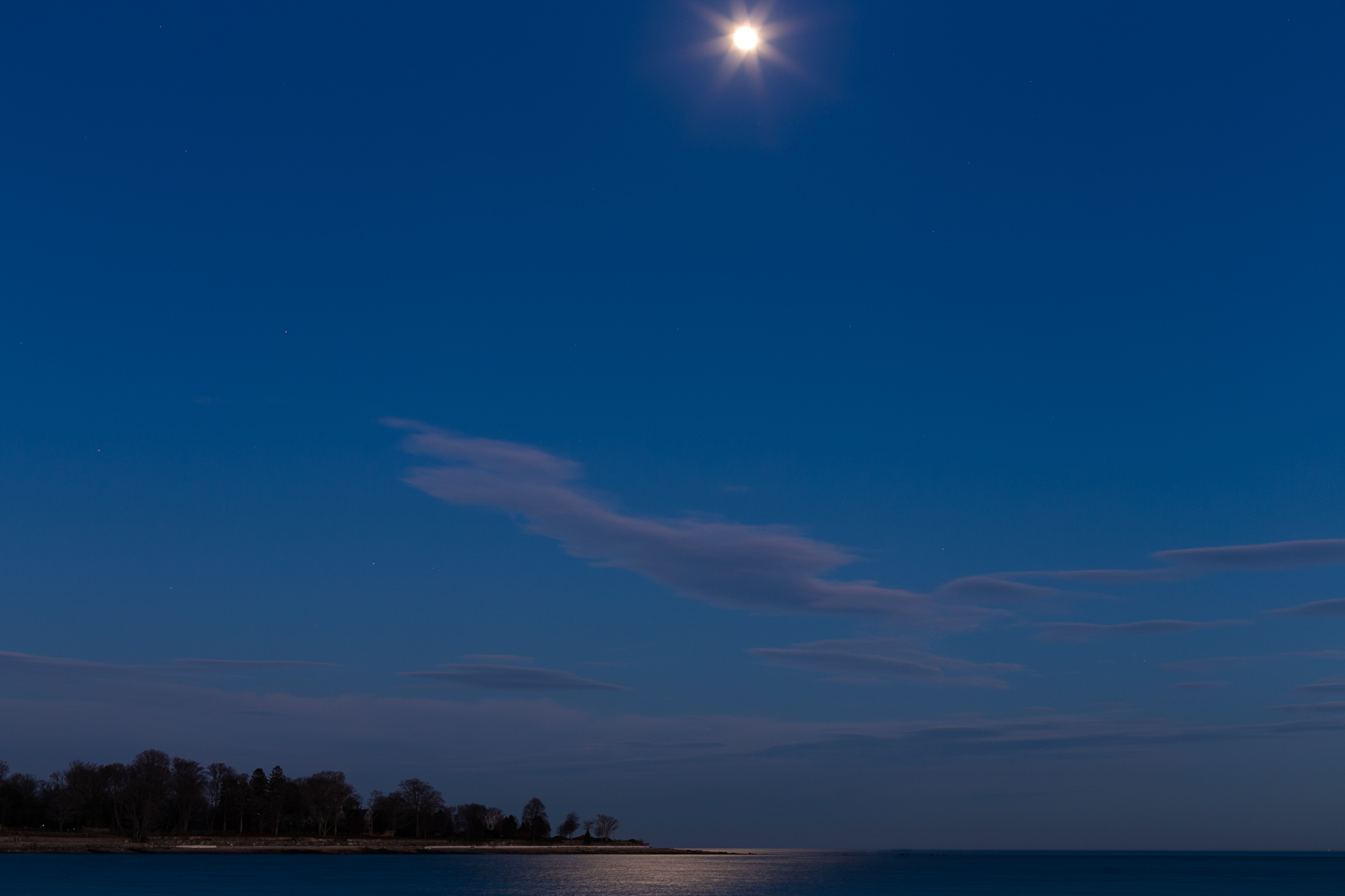 Burying Hill Beach in Westport, CT looks other worldly on a moonlit night