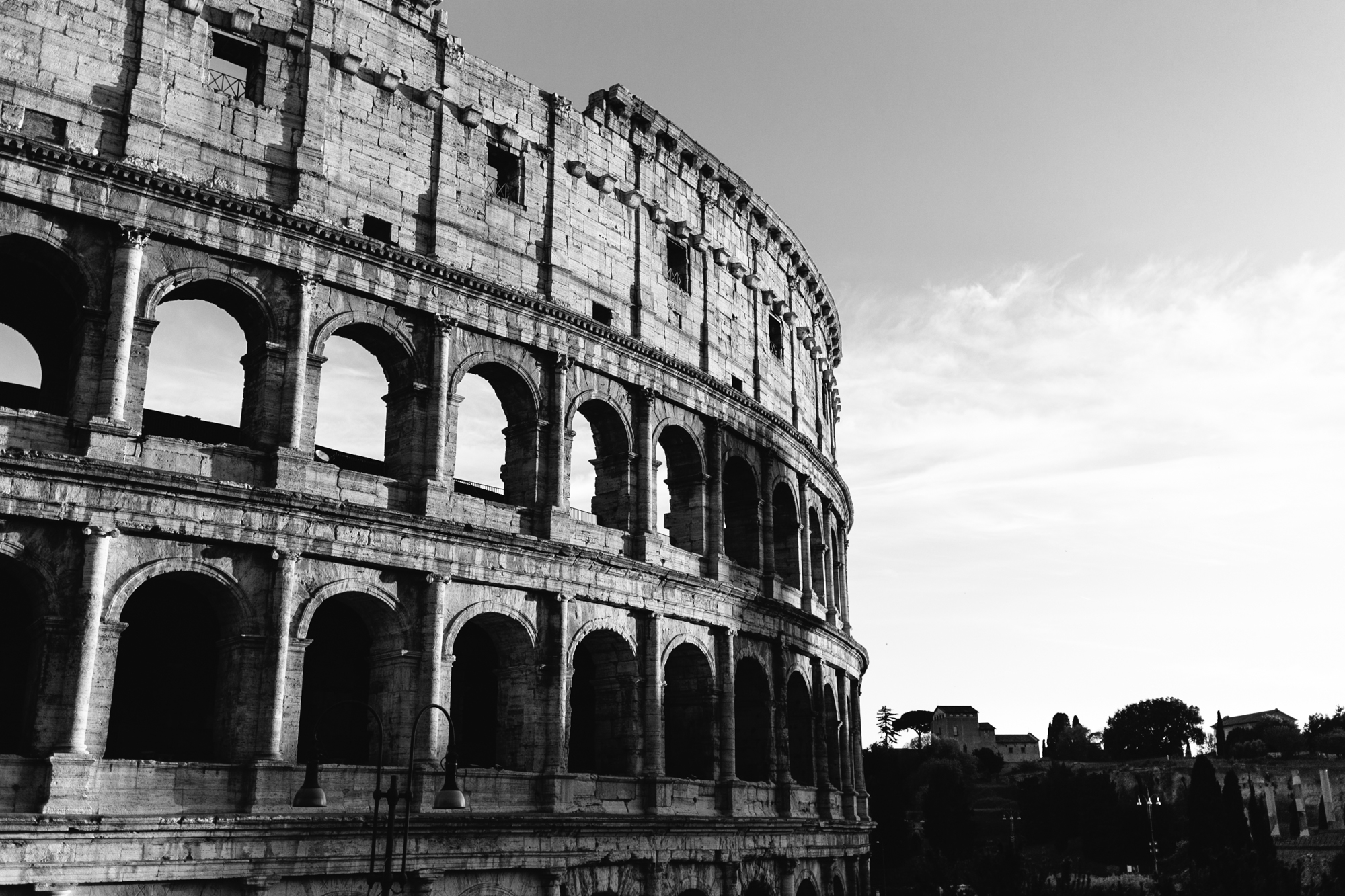 The sun sets on the Colisseum in Rome, Italy