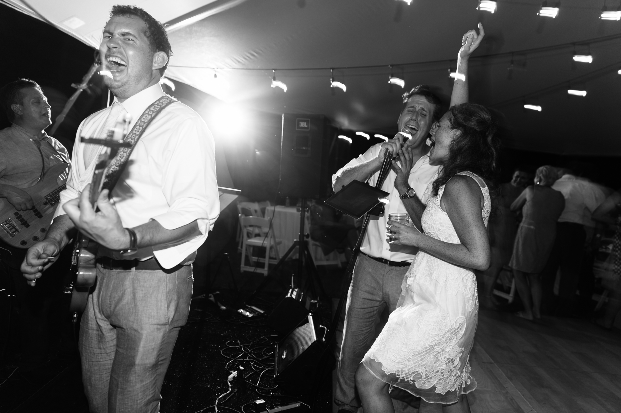 The groom jams with the band on his wedding day while his (new) wife supplies background vocals