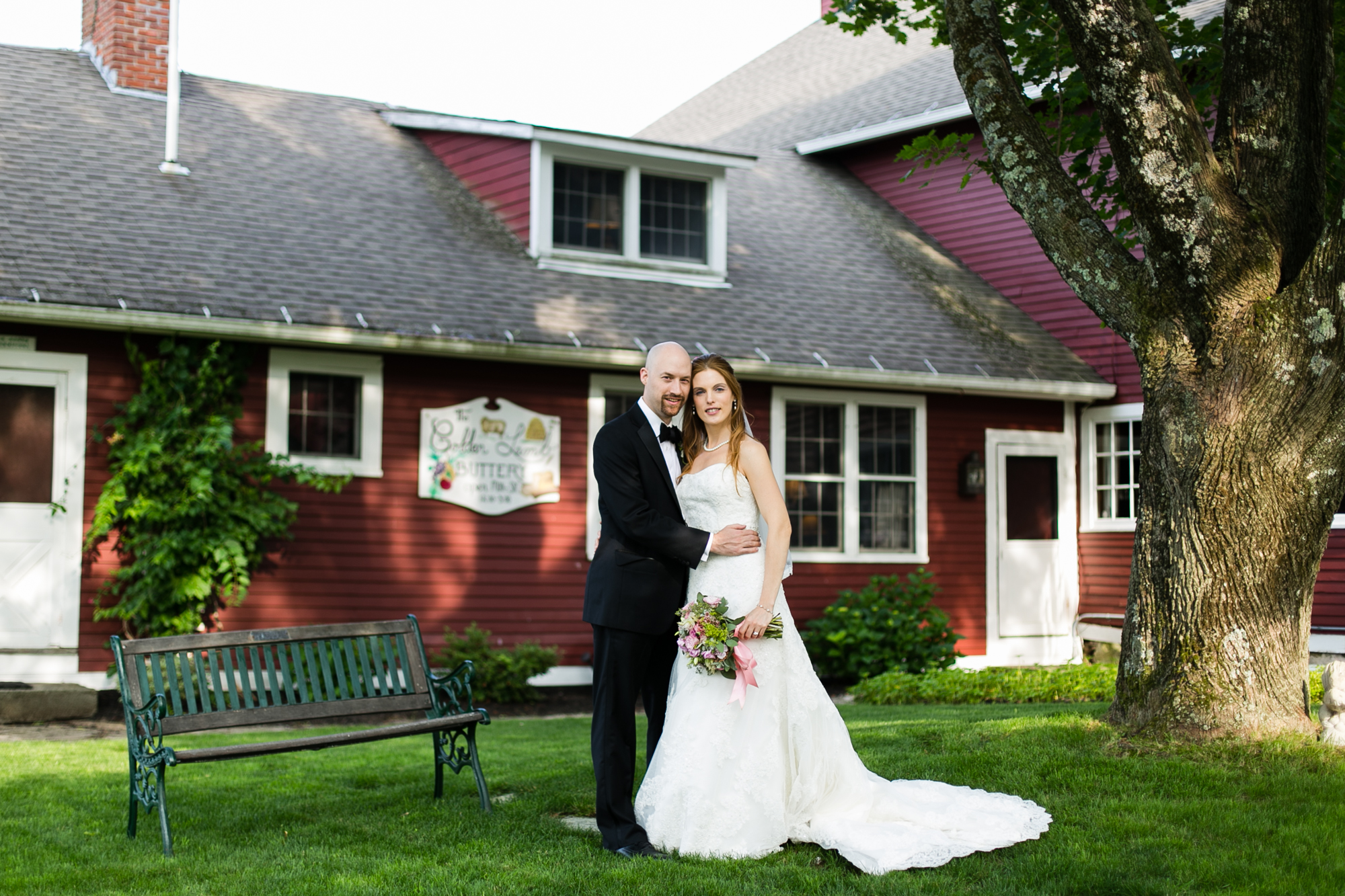 Photo of a bride and grom outside on the ground of the Golden Lamb Buttery wedding venue in Brooklyn, CT
