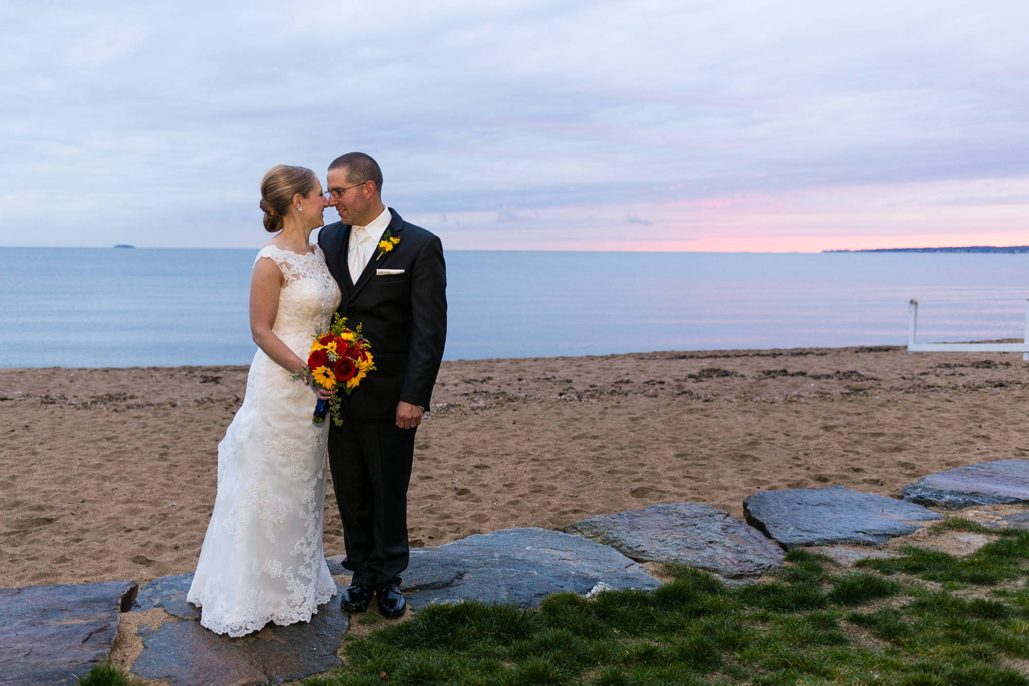 Photo of a bride and groom at sunset on the beach at Madison Beach Hotel wedding venue