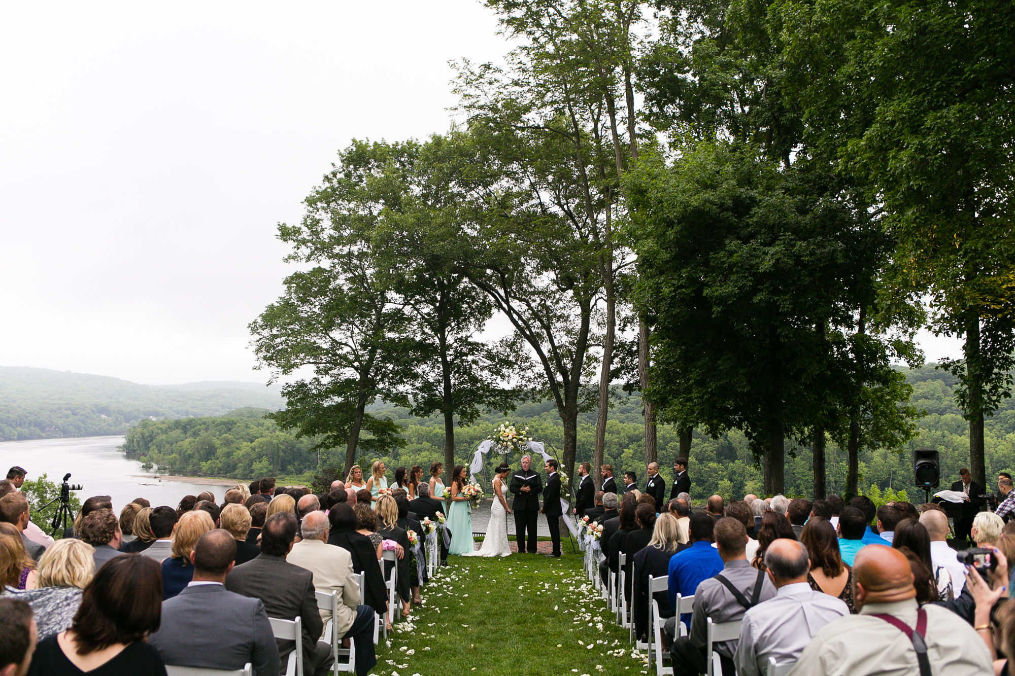photo of an outdoor ceremony on the CT River at Saint Clements Castle in Portland, CT