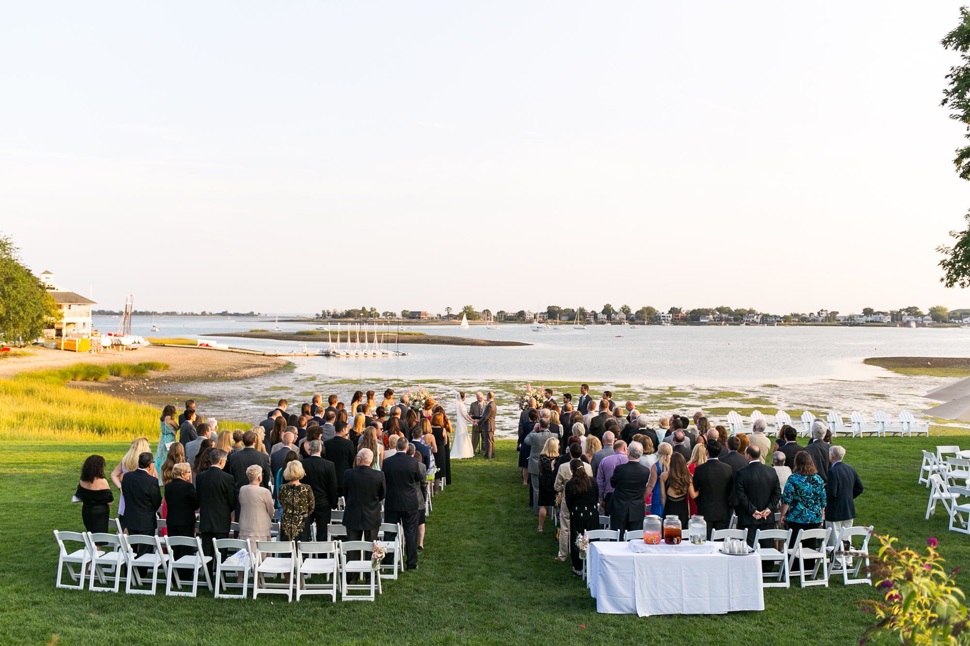 Photo of an outdoor ceremony on the water in CT at the Inn at Longshore Westport, CT