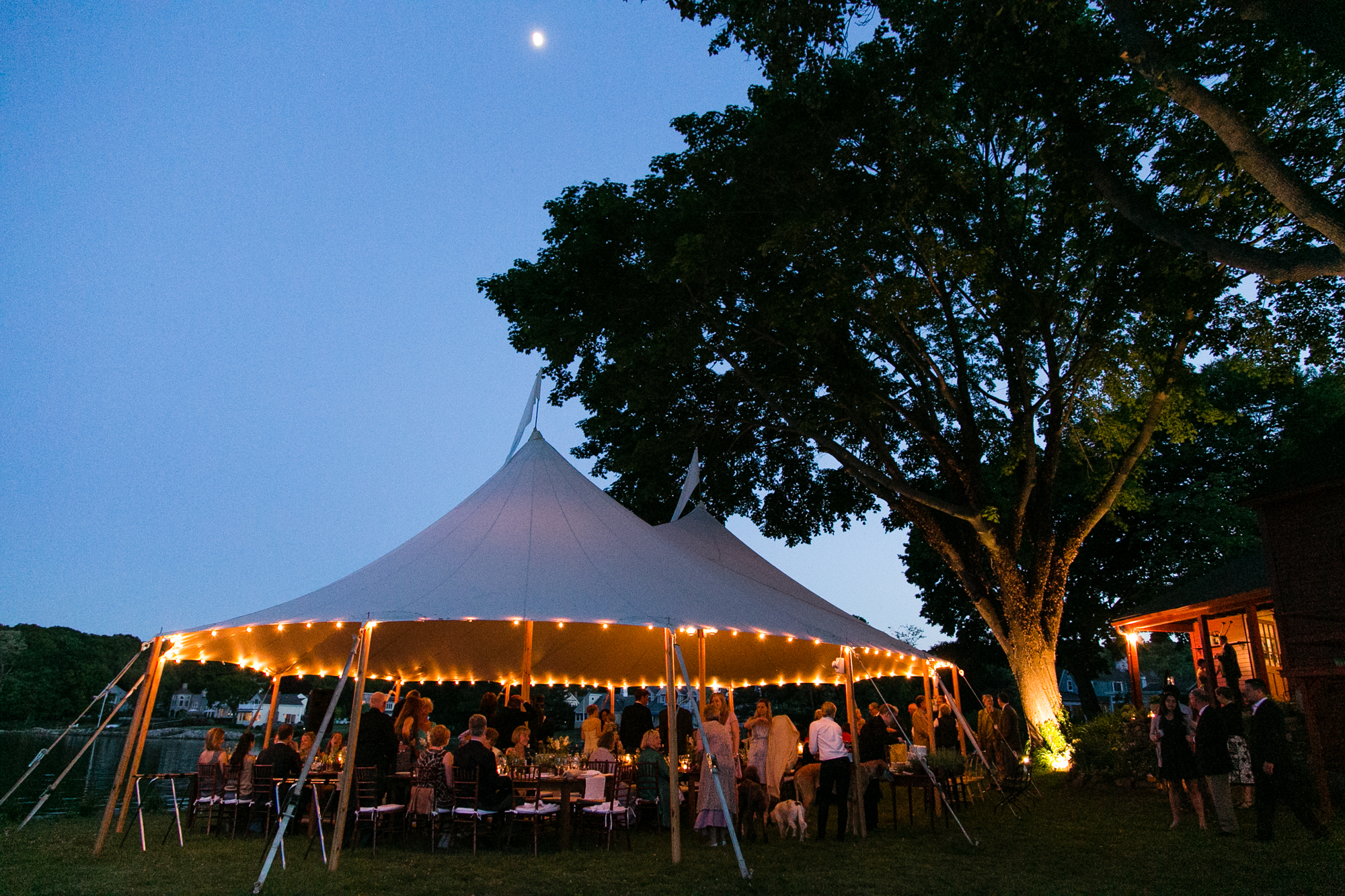 A photo of a tented wedding reception in Essex, CT